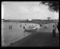 Bringing a rowboat to shore, Orchard Beach, Bronx, N.Y., 1907.
