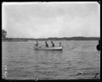 Three unidentified men and a little girl in a rowboat, Orchard Beach, Bronx, N.Y., 1907.