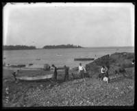 Young men on a rocky beach, Orchard Beach, Bronx, N.Y., 1907.
