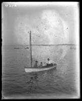 Unidentified man and two boys in a small sailboat, Orchard Beach, Bronx, N.Y., 1908.