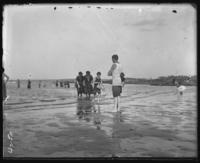 Bathers on the beach, Orchard Beach, Bronx, N.Y., 1908.