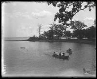 Boats in an inlet, with tents beyond, Orchard Beach, Bronx, N.Y., 1910.