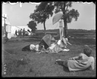 Campers relaxing, Orchard Beach, Bronx, N.Y., 1910.