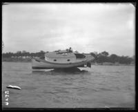 Motor boat stranded on a rock, Orchard Beach, Bronx, N.Y., 1910.