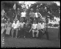 Group of unidentified men and boys with little flags, Orchard Beach, Bronx, N.Y., 1910.