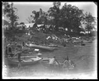 Campsites at the shore, Orchard Beach, Bronx, N.Y., 1907.