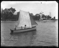 Unidentified boys [including Willie and Georgie Stonebridge] in a sailboat [the 'Grace Adele'], Orchard Beach, Bronx, N.Y., 1910.