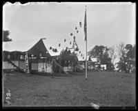 Campsite decorated with lanterns, Orchard Beach, Bronx, N.Y., 1910.