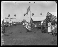 Campsites decorated for Labor Day, Orchard Beach, Bronx, N.Y., September 5, 1910.