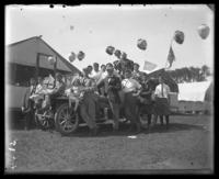 Unidentified group piled on and around a car, Labor Day, Orchard Beach, Bronx, N.Y., September 5, 1910.
