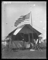 Campsite decorated for Labor Day, Orchard Beach, Bronx, N.Y., September 5, 1910.