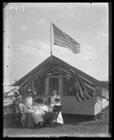 Tent 'Camp Cecelia' decorated for Labor Day with unidentified family seated in front, Orchard Beach, Bronx, N.Y., September 5, 1910.