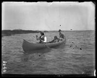 Labor Day, two unidentified men and a girl in a canoe, Orchard Beach, Bronx, N.Y., September 5, 1910.