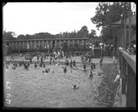 Bath houses and bathers, Orchard Beach, Bronx, N.Y., 1912.