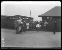 Line waiting to enter the bathhouse, Orchard Beach, Bronx, N.Y., 1915.
