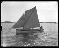 Unidentified boys in the sailboat Grace Adele, Orchard Beach, Bronx, N.Y., undated [c. 1900-1914].