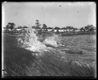 Waves breaking on the shore below the campsites, Orchard Beach, Bronx, N.Y., 1911.