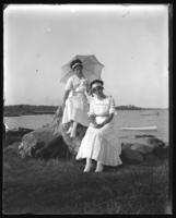 Grace Stonebridge and an unidentified girl [boy?] seated on driftwood, Orchard Beach, Bronx, N.Y., 1911.