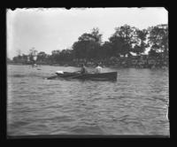 Two unidentified men in a rowboat, Orchard Beach, Bronx, N.Y., 1909.