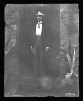 Unidentified man on the stoop of the Northern Gaslight Company office, Bronx, N.Y., undated [c. 1900].