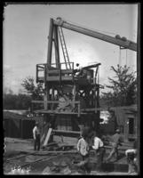Equipment for constructing the new concrete bridge over the Hutchinson River to Pelham Bay Park, Bronx, N.Y., undated [c. 1903].