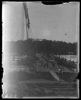 Dismantling the old iron Pelham Bridge while laying the foundations for the new concrete one, Bronx, N.Y., undated [c. 1903].