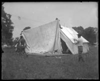 Unidentified 22nd Battalion men putting up a tent, State Camp (Camp Smith), Peekskill, N.Y., June 13, 1903.