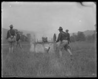 Second Battery men firing a gun, State Camp (Camp Smith), Peekskill, N.Y., September 5-7, 1903.
