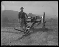 Man of the Second Battery next to a gun, State Camp (Camp Smith), Peekskill, N.Y., September 5-7, 1903.