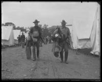 Carrying gear in camp, State Camp (Camp Smith), Peekskill, N.Y., 1907.