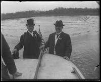 Two unidentified congressmen from the Congressional Rivers & Harbors Committee on a launch during a visit to New York City, May 5-6, 1903.