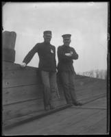 Two unidentified military officers aboard the 'Fulton Market' during an excursion with the North Side Board of Trade and the Congressional Rivers & Harbors Committee, New York City, May 5 or 6, 1903.