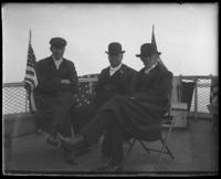Rep. Stephen M. Sparkman and two other unidentified congressmen from the Committee on Rivers and Harbors on the deck of the 'Fulton Market' during a visit to New York City, May 5 or 6, 1903.