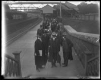 Unidentified officials from the North Side Board of Trade and the Congressional Committee on Rivers and Harbors at an unidentified train station, Yonkers, N.Y. [?], 1906.