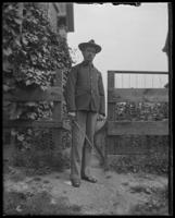 George E. Stonebridge in uniform, carrying a sword, Bronx, N.Y. [?], undated [c. 1910?].