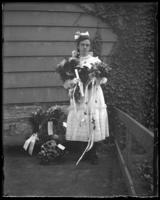 Grace Stonebridge holding a diploma, surrounded by flowers, Bronx, N.Y. [?], undated [c. 1907?].