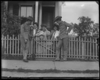 'The boys are coming home today': standing at the gate, Bronx, N.Y., undated [c. 1905-1910?]