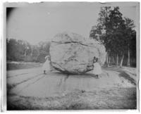 Grace and Willie Stonebridge beside the Rocking Stone, Bronx Park, Bronx, N.Y., 1902.