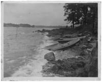 Rowboats pulled up onto the rocks, Orchard Beach, Bronx, N.Y., 1909.