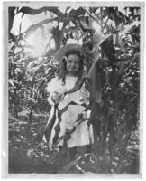 Matted print of Grace Stonebridge standing in a cornfield, Garrison, N.Y., undated [c. 1898?].