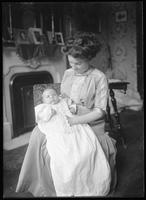 Portrait of an unidentified woman holding a baby, undated (ca. 1911-1921).