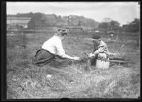 Ethel Magaw Hassler and William Gray Hassler picnicking in a field, Inwood (?), undated (ca. 1911).