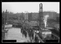 Unidentified dock under construction, Brooklyn, undated (ca. September 1916). Photographed for the Robbins Ripley Company. View from the far end of the dock looking toward land.