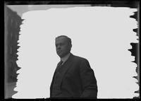 Unidentified man in a suit, New York City, undated (ca. 1917). Background matted out.