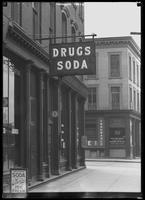 Drugs & Soda sign, 69 Broadway, Flushing, Queens, undated (ca. June 1917).  Photographed for Lawrence L. Strauss.