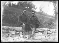 Frank Rogers Hassler (right) and unidentified companion, in army uniform seated on a stone wall, August 12, 1917