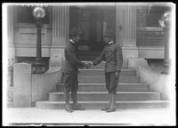 Frank Rogers Hassler (right) and unidentified companion in army uniform, shaking hands outside 150 Vermilyea Avenue, New York City, August 12, 1917