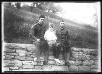 Frank Rogers Hassler (in uniform, right), William Gray Hassler (center), and unidentified companion, seated on a stone wall, August 12, 1917