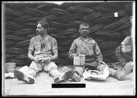 Laborers seated with their lunch pails, New York City, undated (ca. September 1917).