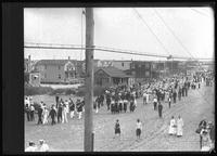Crowds at a small seaside parade (Labor Day?), Brooklyn or Queens, undated (ca. September 1917).